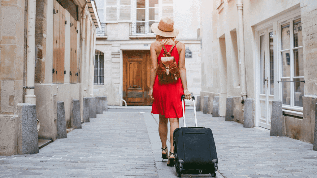 women in Europe with roller suitcase