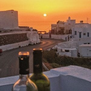 wine and sunset in Santorini, Greece itinerary