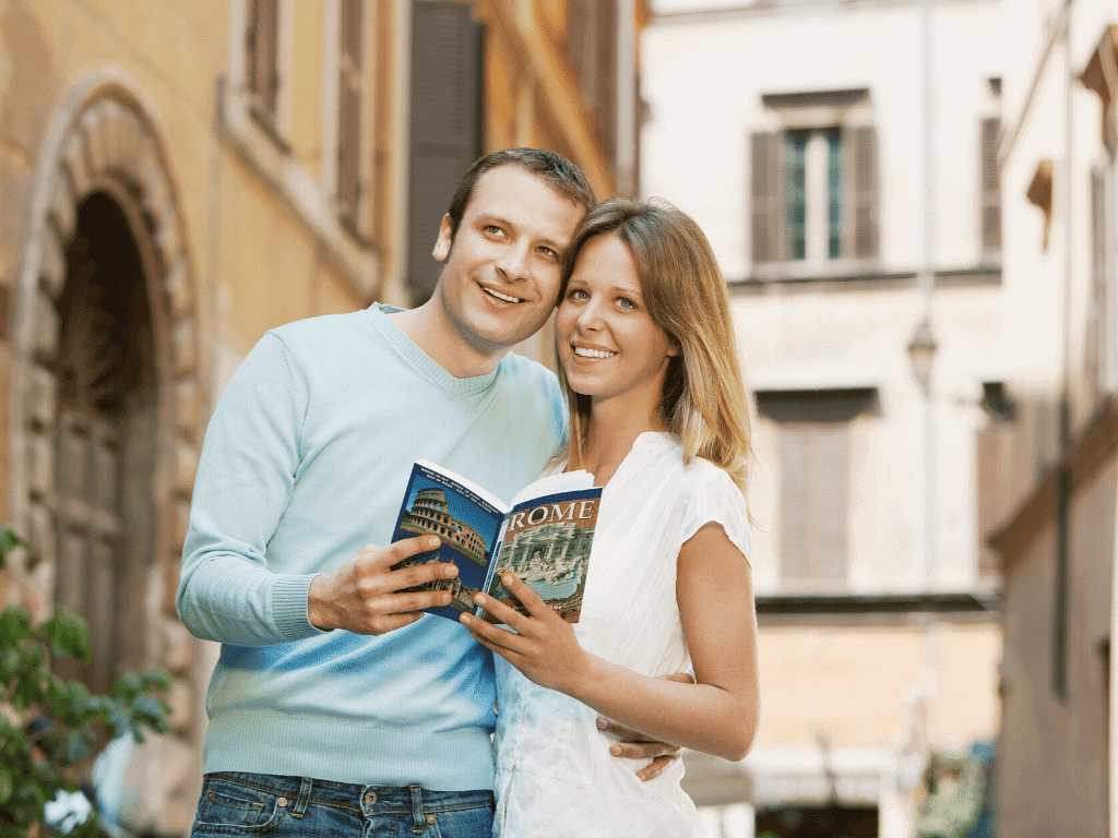 Couple looking at Europe Guidebook