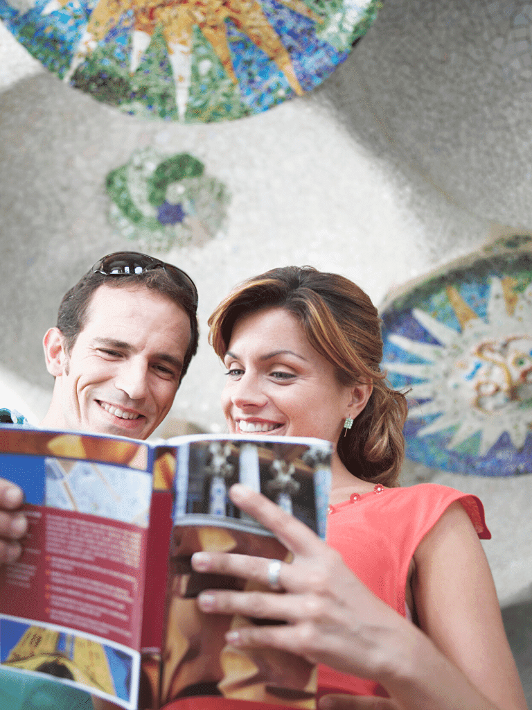 Travelers reading a guidebook in Barcelona