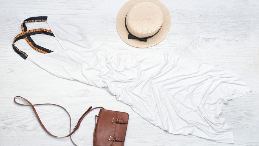 white dress flatlay travel capsule wardrobe