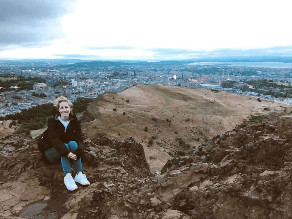 hiking arthurs seat in comfortable white sneakers