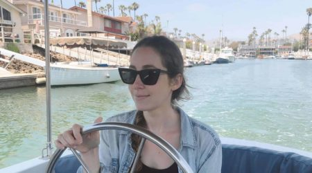 steering a boat in quay sunglasses